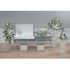 DiBella Flowers & Gifts Las Vegas - White Tribute Collection- 5 pieces- CTT 2-11,12,3-11,12,13 Includes Standing Spray, Pillow lid Decoration,Casket Spray, Pedestal Arrangement and Statue arrangement.  White Roses, Dendrobiums, Snapdragons, Lilies, Stock Carnations and Daisies.