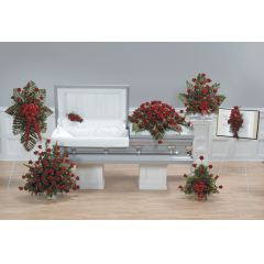 DiBella Flowers & Gifts Las Vegas - Red Rose Tribute Funeral Package CTT18-11,12,13,CTT19-11,12,13,14 Includes Red Rose Standing Spray, Cross Lid Decoration, Large Mache Arrangement, Casket Spray, Pedestal Arrangement, Bible Standing Spray and Small basket arrangement.