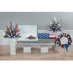 DiBella Flowers & Gifts Las Vegas - Red, White and Blue Funeral Tribute Package CTT28-11, 12, CTT29-11, 12. Includes Red white and blue mache arrangement, lid decoration, additional mache arrangement and wreath.