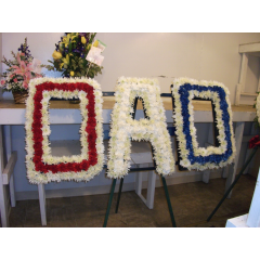 DiBella Flowers & Gifts Las Vegas - Dad Custom Funeral Piece- We can custom make any name. Please call for details and pricing.