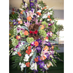 DiBella Flowers & Gifts Las Vegas - Custom Standing Sprays with Item We can incorporate any personal item into a design.  Call for details and pricing.
