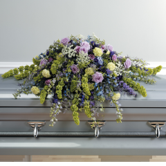 DiBella Flowers & Gifts Las Vegas - Purple Garden Casket Spray CTT 55-11  *** Bells of Ireland (Green Flowers) are seasonal and may be subbed ***