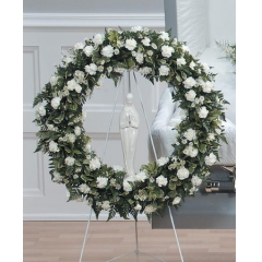 DiBella Flowers & Gifts Las Vegas - White and Green Sympathy Wreath CTT10-11 Soft greens, white filler and mini carnations.