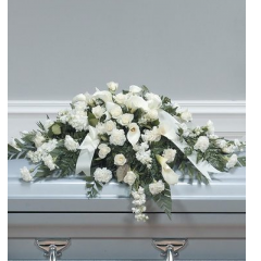 DiBella Flowers & Gifts Las Vegas - White Calla and Rose Casket Spray CTT14-12 This soft white casket piece includes White roses, calla lilies, carnations and other white flowers.