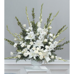 DiBella Flowers & Gifts Las Vegas - Graceful white urn CTT15-11 Roses, lilies, carnations, gladiolus and poms in a white urn style vase.
