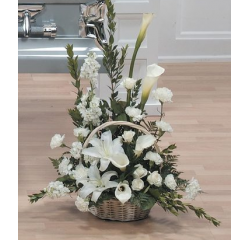 DiBella Flowers & Gifts Las Vegas - Graceful White Basket Arrangement CTT15-12 Lilies, roses and more fill this beautiful basket arrangement.
