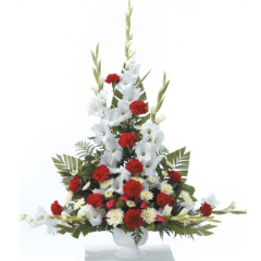 DiBella Flowers & Gifts Las Vegas - Red and White Urn Arrangement CTT24-21 Red carnations, white gladiolus and poms in this beautiful bouquet.