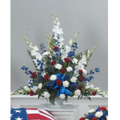 DiBella Flowers & Gifts Las Vegas - Traditional Red, White and Blue Mache CTT29-11 Red roses, Carnations, Gladiolus and Delphinium.