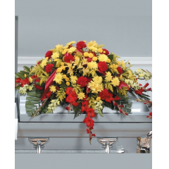DiBella Flowers & Gifts Las Vegas - Red and Yellow Casket Spray CTT43-11 Carnations, Alstromeria, Snapdragons, Poms and Gladiolus.