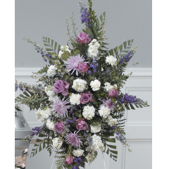 DiBella Flowers & Gifts Las Vegas - White and Lavender Standing Spray CTT49-12 Lavender Roses, Larkspur, Mums, Carnations and more.