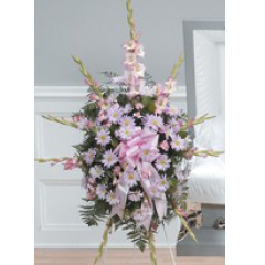 DiBella Flowers & Gifts Las Vegas - Pinks and Lavenders Standing Spray CTT68-11 Daisy poms, Carnations and Gladiolus.