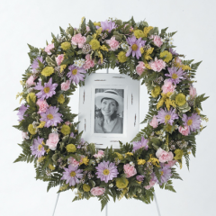 DiBella Flowers & Gifts Las Vegas - Lavender Pink and Yellow Wreath CTT92-21 ** 8x10 picture needs to be provided 3 days before service**  Specify in instructions if no picture is needed.