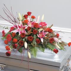 DiBella Flowers & Gifts Las Vegas - Red Stylized Casket Spray CTT 90-11 Red Roses, Stargazers, Gerbera Daisies and Carnations.