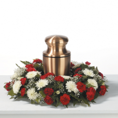 DiBella Flowers & Gifts Las Vegas - Red & White Urn Wreath CTT25-11 The prefect setting for your loved ones ashes. This urn wreath is filled with Red Miniature Carnations, White Daisy Poms and Babies Breath.