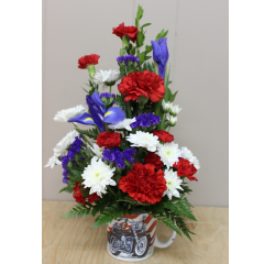 DiBella Flowers & Gifts Las Vegas - The Crusin' Mug Arrangement  Send this adorable keepsake mug arrangement to the motorcycle fan in your life! Includes red, white and blue, Carnation, Iris and Daisies.