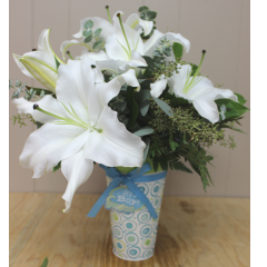 Precious Baby Boy White Stargazer lilies in an adorable keepsake baby tin.