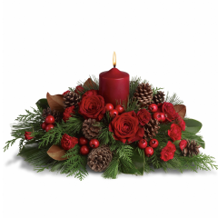 "DiBella Flowers & Gifts Las Vegas - Season Glow  Spread the spirit of the holiday season by sending this lovely holiday arrangement to the home of friends and family. The low profile makes it a perfect centerpiece, although it will be equally at home in any room. Gorgeous red roses and spray roses, berry sprays and carnations are arranged with pinecones and festive greenery. A great way to serve up holiday cheer! Approximately 22"" W x 12 1/4"" H by Teleflora **No candle on Standard version**"