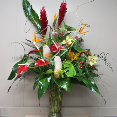 DiBella Flowers & Gifts Las Vegas - Birds of Paradise, Ginger, Cymbiudium Orchids, Anthirium, Protea and Lush tropical greens.