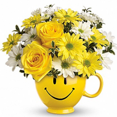 DiBella Flowers & Gifts Las Vegas - Teleflora's Be Happy Bouquet When you're looking to make someone smile, this happy face mug of roses and daisies is tops. Sure to cheer up everyone from a beloved wife to a busy boss, these are also great flowers for kids.