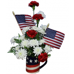 DiBella Flowers & Gifts Las Vegas - Red, White and Blue Mug Arrangement  Carns and Poms in a flag themed keepsake mug with flags!