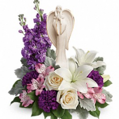 An elegantly unique expression of your love, this majestic mix of crème, white and lavender blooms includes fragrant roses and lilies to refresh and rejuvenate their spirits. Nestled among the blooms is a graceful angel sculpture - a serene, spiritual keepsake they'll always treasure.