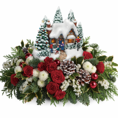 "DiBella Flowers & Gifts Las Vegas - 2015 Thomas Kinkade's Country Christmas Homecoming Make this Christmas one to remember with Thomas Kinkade! Inspired by his beloved artwork, this hand-sculpted, hand-painted keepsake cottage glows warmly above a wondrous winter bouquet of radiant red roses, snow white mums and fresh noble fir. Its joyful Christmas scene makes everyone smile! Standard Version is made without roses.  * Deluxe Version Shown Approximately 16"" W x 10"" H"