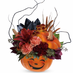"DiBella Flowers & Gifts Las Vegas - Teleflora's Halloween Magic Bouquet What a ""boo""-tiful way to wish them a Happy Halloween! This spirited mix of lilies, carnations, mums and fun fall accents is hand-delivered in a delightful ceramic pumpkin, the perfect Halloween candy jar! Approximately 14 3/4"" W x 19 3/4"" H"