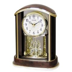 "DiBella Flowers & Gifts Las Vegas - Rhythm Clocks Crystal Flare Time-Only Quartz (battery-operated) desk/mantel clock. Rotating pendulum with 8 genuine Swarovski crystals. Encased in a plastic, elegant faux burlwood case. Measures 11.6""""H x 9""""W."