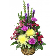 DiBella Flowers & Gifts Las Vegas - Yours Truly Bouquet  Bright yellow Spider Mums, Carnations, Alstromeria Lilies and more in a dark brown wicker basket. Sure to brighten up any room for any occasion!
