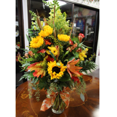 DiBella Flowers & Gifts Las Vegas - Colors of Fall This gorgeous fall vase arrangement is sure to please. Featuring Sunflowers, Snapdragons, Lilies, Alstromeria, fall leaves and seasonal greens.