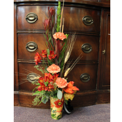 DiBella Flowers & Gifts Las Vegas - Fresh Fall Travel Mug Featuring Safari Sunset, Carnations, Alstromeria, wheat and cattails in a keepsake travel mug.