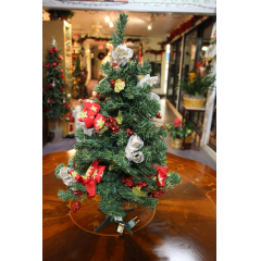 DiBella Flowers & Gifts Las Vegas - Christmas Mini Tree- Artificial Decorated, including lights this adorable artificial tree is a great gift for a home of office. Stands approximately 2 foot. ** Decorations will vary