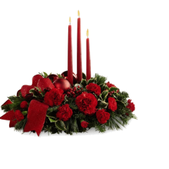 DiBella Flowers & Gifts Las Vegas -  Lights of the Season Centerpiece is an exquisite way to bring the magic of the holiday season to your celebrations with family and friends. Brilliant red carnations and mini carnations are gorgeously arranged amongst variegated holly and an assortment of holiday greens. Accented with red glass balls and a bright red wired ribbon, this arrangement encircles 3 red taper candles to bring the perfect glow to your festivities.