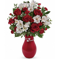 Pair Of Hearts Bouquet by Teleflora Perfectly romantic! Steal her heart this Valentine's Day with this majestic mix of classic red roses and delicate white alstroemeria, hand-delivered with love in our exclusive hand-glazed vase. Wrapped in a shimmering metallic band adorned with a pair of hearts, it's an extra-special reminder of your love.