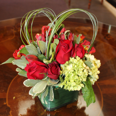 DiBella Flowers & Gifts Las Vegas - Hearts on Fire Mix of fiery red roses and alsrtomeria lilies, green hydrangea and bear grass heart detail.