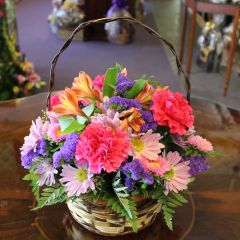 DiBella Flowers & Gifts Las Vegas - Sweet Memories of You Wicker basket full of fresh Carnations, Alstromeria Lilies and Daisies