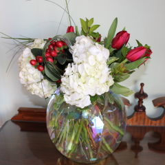 DiBella Flowers & Gifts Las Vegas - Eternally Yours Coffee Bean, Hydrangea, Red Roses and Tulips in a clear glass bubble bowl