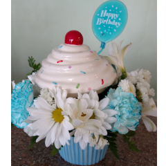 DiBella Flowers & Gifts Las Vegas - Happy Birthday, Cupcake! Fresh birthday blooms in a hand-painted ceramic cupcake dish in blue and pink with removable lid. Lids are white icing with colorful sprinkles and a red cherry on top.  Comes in Blue and Pink Please choose color or will be as shown
