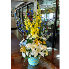 DiBella Flowers & Gifts Las Vegas - Baby Boy Chevron Print Welcome your newest addition with this adorable sweet baby bouquet.  In a keepsake chevron print with lilies, carnations, delphinium, snapdragons and more!