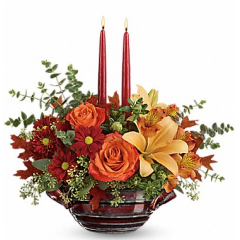 DiBella Flowers & Gifts Las Vegas - Make your autumn gathering extra special with this fabulous centerpiece of fresh fall roses, lilies and alstroemeria - expertly arranged around glowing candles in a hand-glazed artisanal stoneware bowl. The food-safe, oven-to-table piece is sure to be a serving staple for many gatherings to come! This colorful fall mix includes orange roses, peach asiatic lilies, orange alstroemeria, red daisy spray chrysanthemums, orange safflower, spiral eucalyptus, seeded eucalyptus, and oak leaves along with two burgundy candles. Delivered in Teleflora's Autumn Gathering bowl. Orientation: All-Around