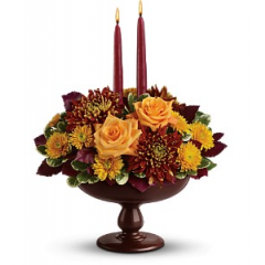"DiBella Flowers & Gifts Las Vegas - Make your Thanksgiving feast even more glorious with radiant autumn flowers in an elegantly crafted lacquered wood pedestal bowl. A centerpiece that will be the center of attention for years to come. The bounteous bouquet includes dark bronze chrysanthemums, orange roses, bronze cushion spray chrysanthemums and burgundy copper beech accented with assorted greenery Delivered in a graceful lacquered wood pedestal bowl Bouquet is approximately 13 1/2"" W X 18 1/2"" H"