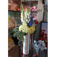DiBella Flowers & Gifts Las Vegas - Light & Peace Bouquet White snapdragons, hydrangea and dark blue delphinium in elegant silver tower cylinder.