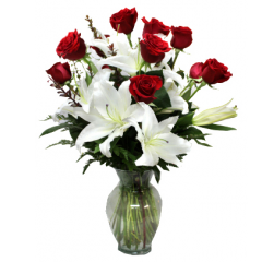 DiBella Flowers & Gifts Las Vegas - One dozen of our premium roses with lush stems of white stargazer lilies. An elegant way to show your love. Please specify color - Red will be sent if no color is chosen  * Valentines pricing may vary