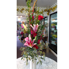 Full, gorgeous mix of stargazer lilies, red gladiolus and romantic red roses in a keepsake silver tower vase. Make a statement!