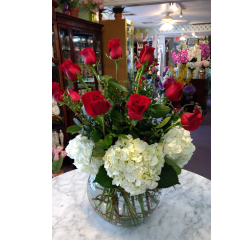 DiBella Flowers & Gifts Las Vegas - A dozen premium long stemmed roses surrounded by white hydrangea in a classic bubble bowl. Classy and elegant!