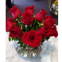 DiBella Flowers & Gifts Las Vegas - A Dozen premium red in a bubble bowl. Approximately 10 inches tall by 10 inches wide.