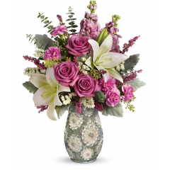DiBella Flowers & Gifts Las Vegas - Send your best spring greetings with this fresh spring surprise! Dramatic roses, lilies and stock in cheerful shades of lavender, white and pink herald the new season in this charming ceramic vase. Hand-painted in soft shades of sage and cream, its alluring pearlized glaze and embossed flower details are sure to make it a perennial spring décor favorite!