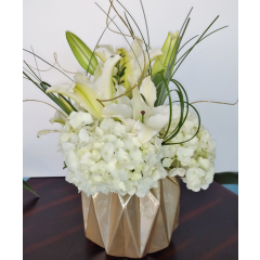 DiBella Flowers & Gifts Las Vegas - A favorite from one of our most talented designers, the Teresa bouquet, is a soft mix of white hydrangea and lilies in a golden art deco ceramic vase.