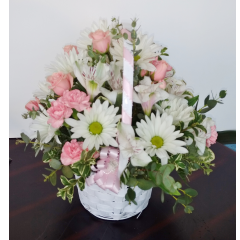 DiBella Flowers & Gifts Las Vegas - Yancy Bouquet A mix of pink spray roses, carnations, alstromeria and daisies in a white wicker basket. Made by our silly girl Yancy who is always ready with a big smile and sweet nature.
