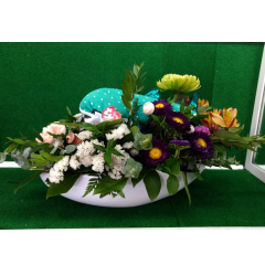 "Fresh sea themed bouquet featuring Destiny from ""Finding Dori"" in white boat ceramic container with shell trim."
